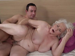 Grey-haired womanlike gets her muted cunt fucked by younger boy